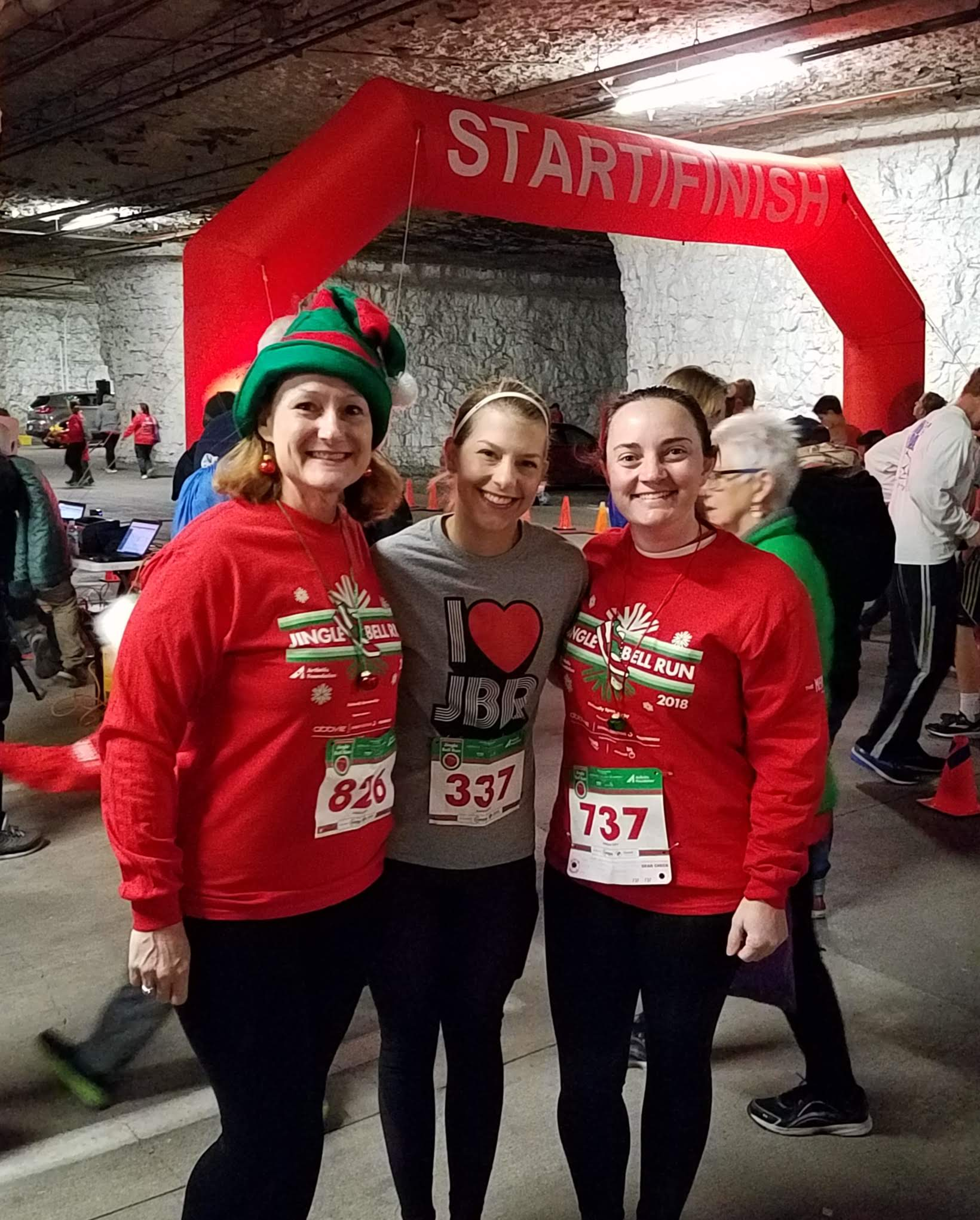 Three sisters running Jingle Bell Run